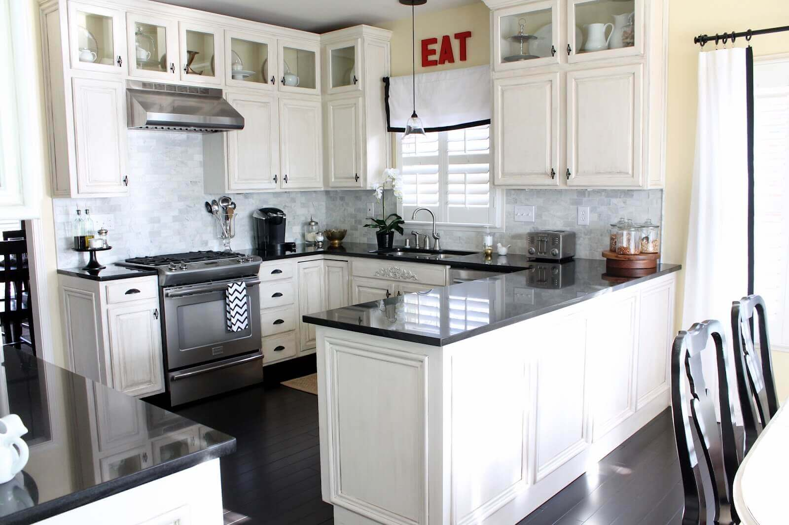 Modern White Kitchen with Black Countertop