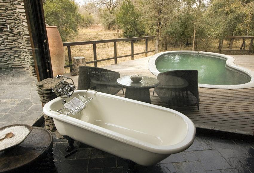 bathtub overlooking african lodge