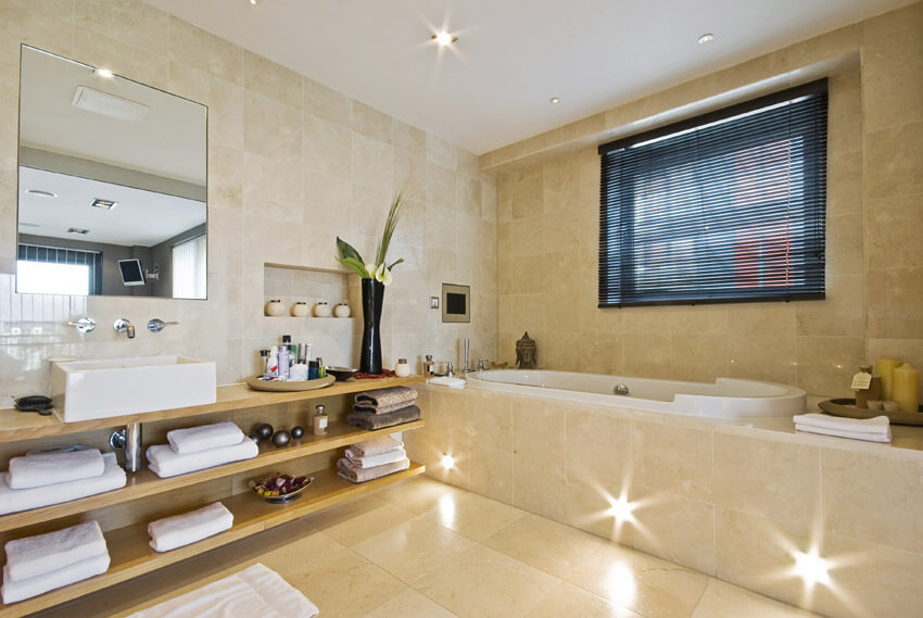 bathtub with enclosure lighting in base