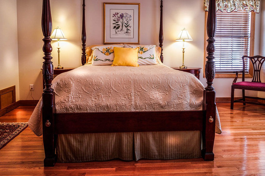 Bedroom with Red Oak Floor and Four Post Bed