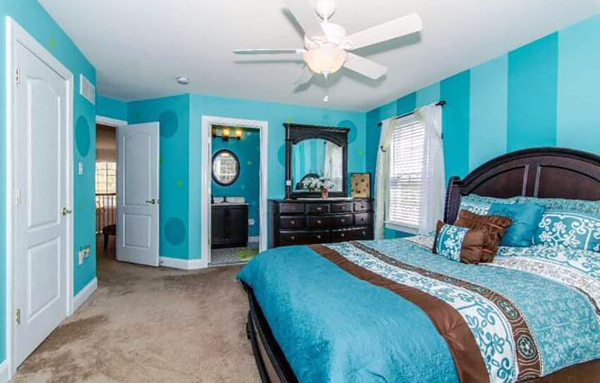 Bedroom with Striped Teal Walls with Circular Designs