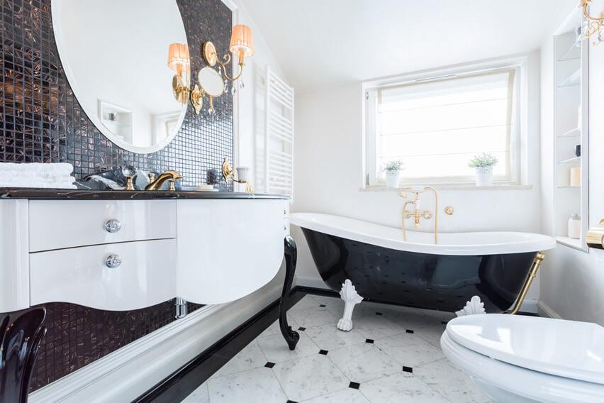 black white bathroom gold finishes