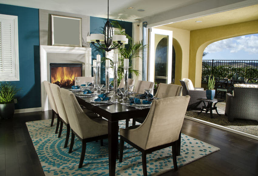 contemporary dining room with blue paint and outdoor views