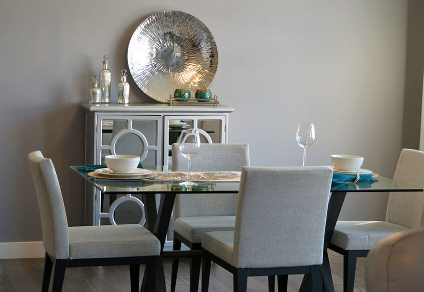 dining room with grey contemporary chairs and glass table