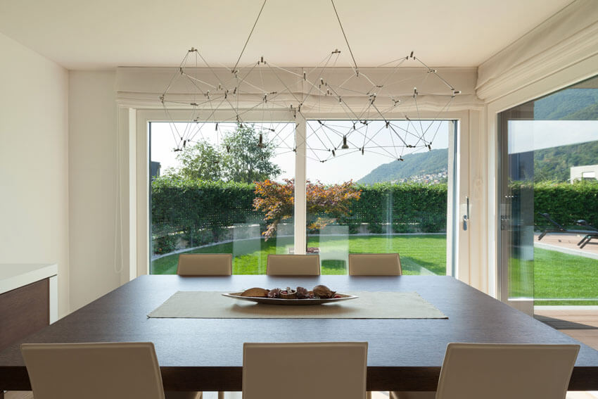 dining room with modern art light fixture