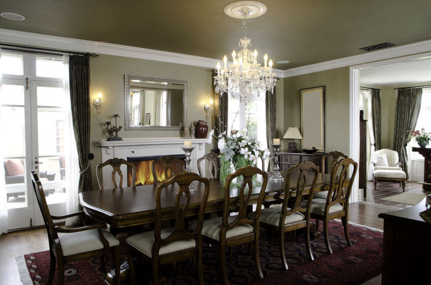 elegant formal dining room with long wood table and fireplace