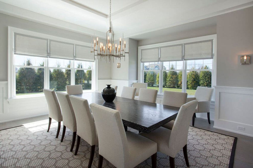 Gray and white dining room with contemporary chandelier