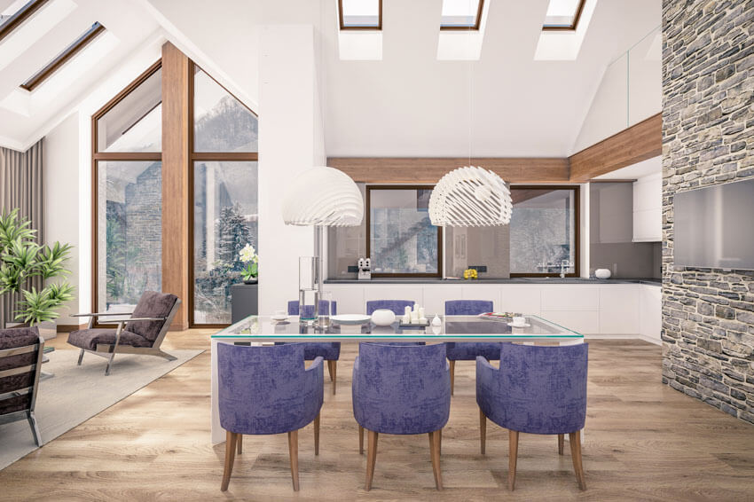 high ceiling dining room with purple chairs