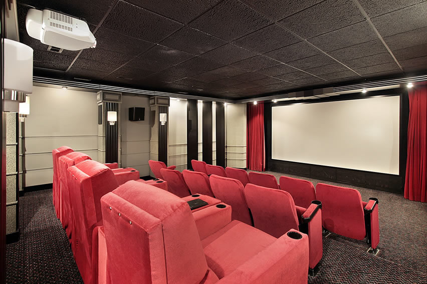 Home Theater Room With Red Cushion Seats