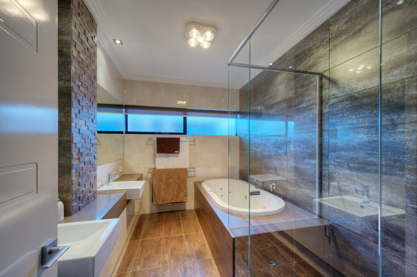 interior designed bathroom with glass shower enclosure