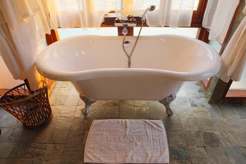 inviting bathtub on natural stone floor