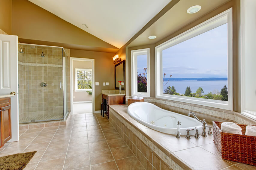 Large master bath water view picture window