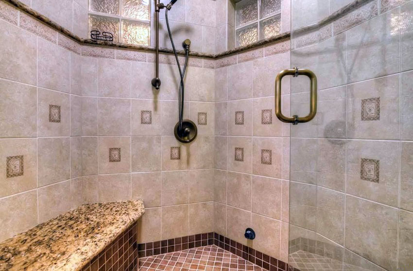 large travertine tile shower with bench