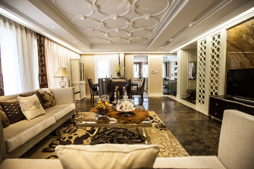 Living Room With Intricate Decor And Designer Furnishings