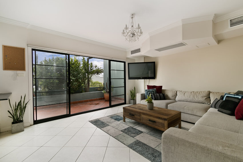 Living Room With Large Sliding Doors To Patio