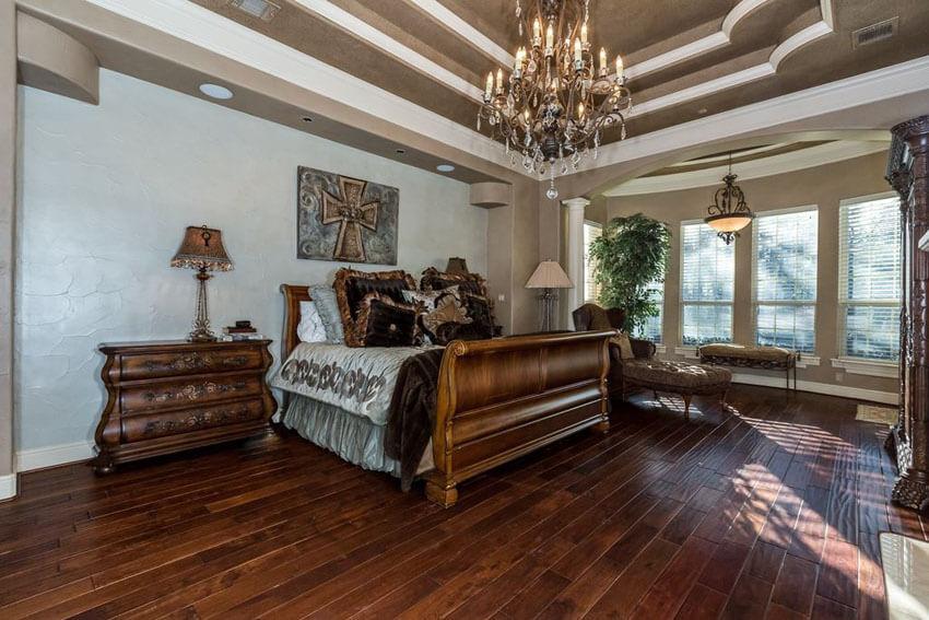 Luxury Master Bedroom with Hickory Hardwood Floors Chandelier and Elegant Furniture