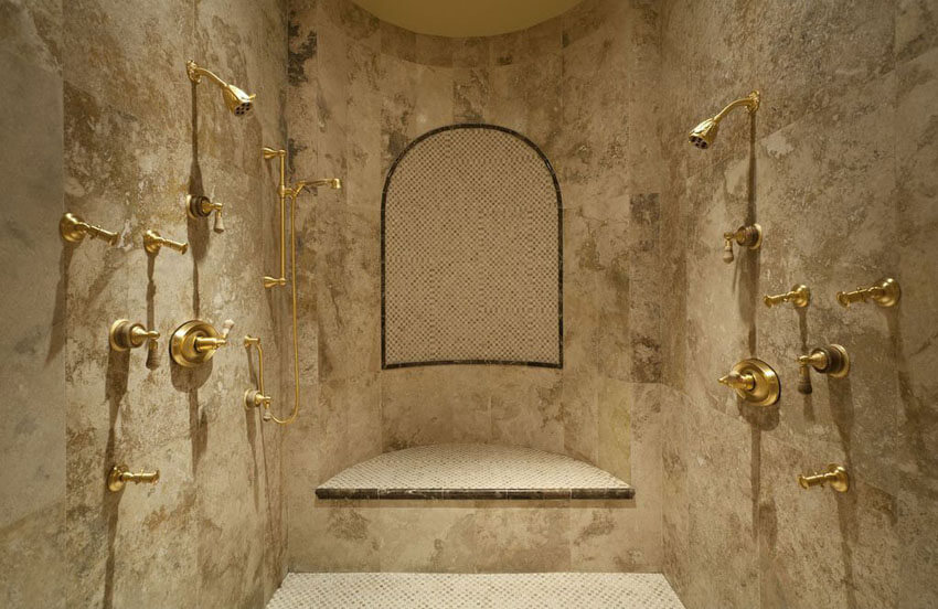 luxury travertine shower with gold fixtures