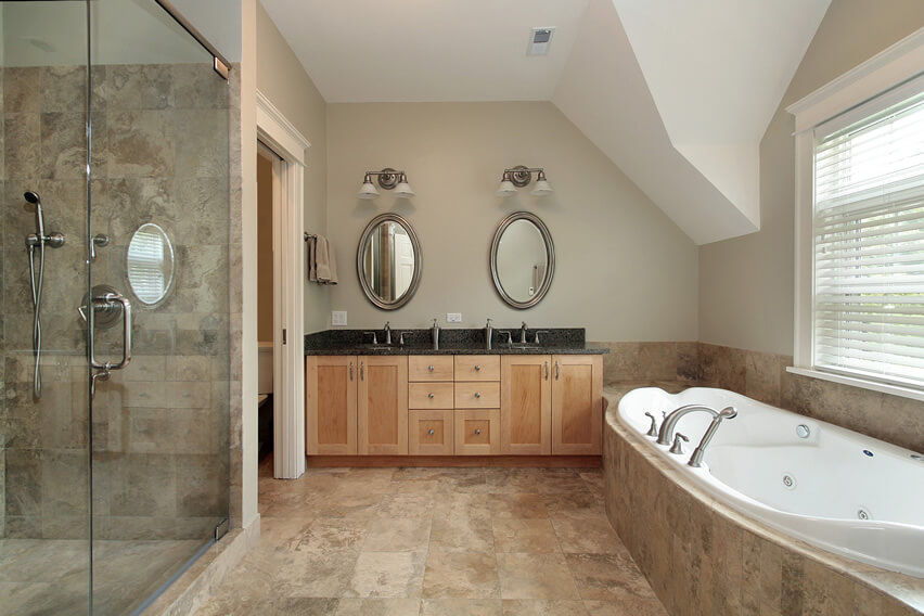 Master bath travertine floor dual sinks and mirrors