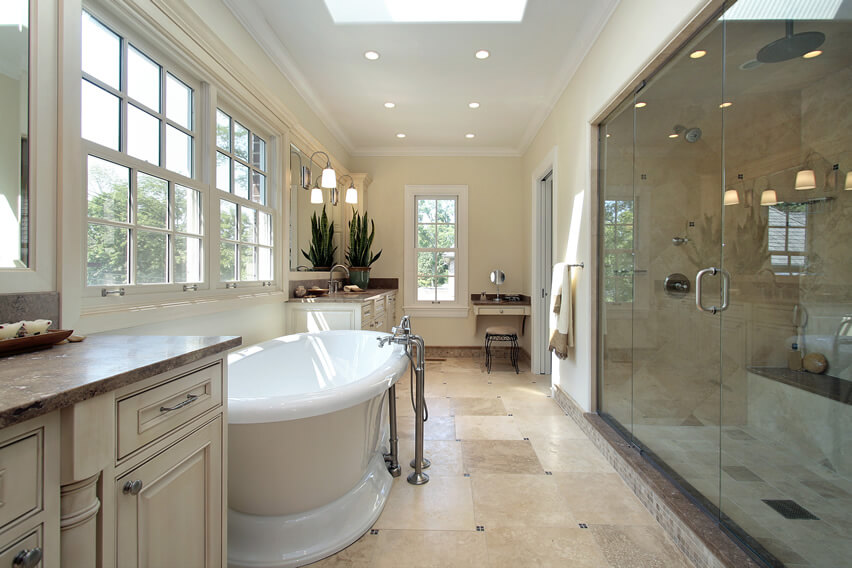 Master bathroom pedestal tub large rainfall shower