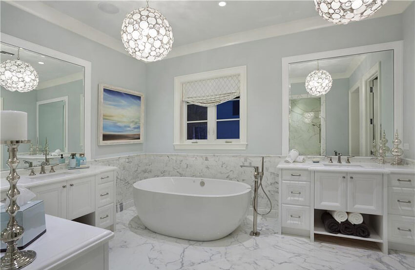 master bathroom with white marble and globe lighting