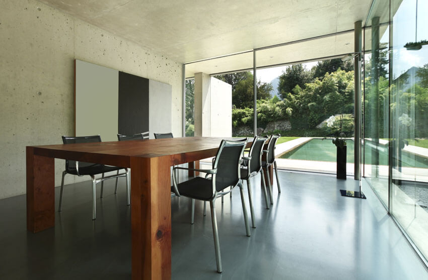 modern concrete living room with thick wood table