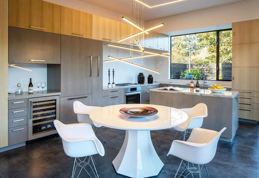 modern dining room with all white table chairs and hanging bars light fixture