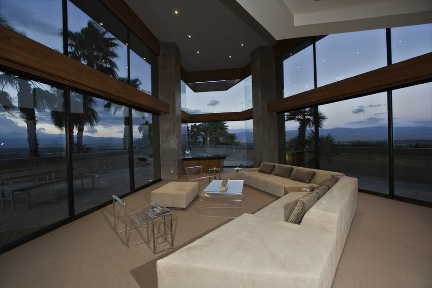 Modern Windowed Living Room With White Sectional Couch
