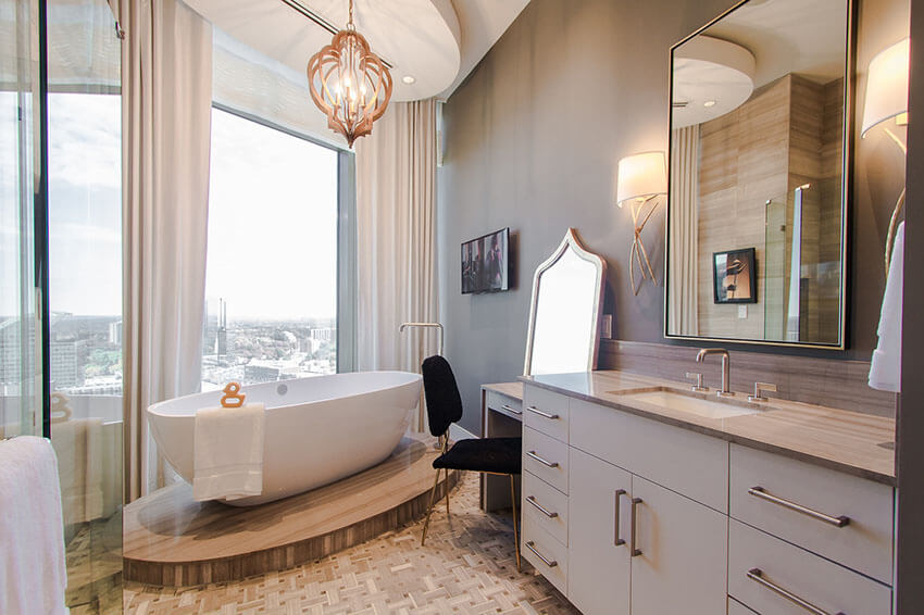 penthouse bathroom with city view from bathtub