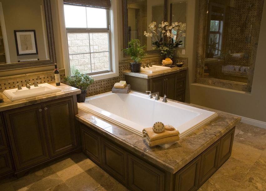 pretty bathroom in beige with large bathtub