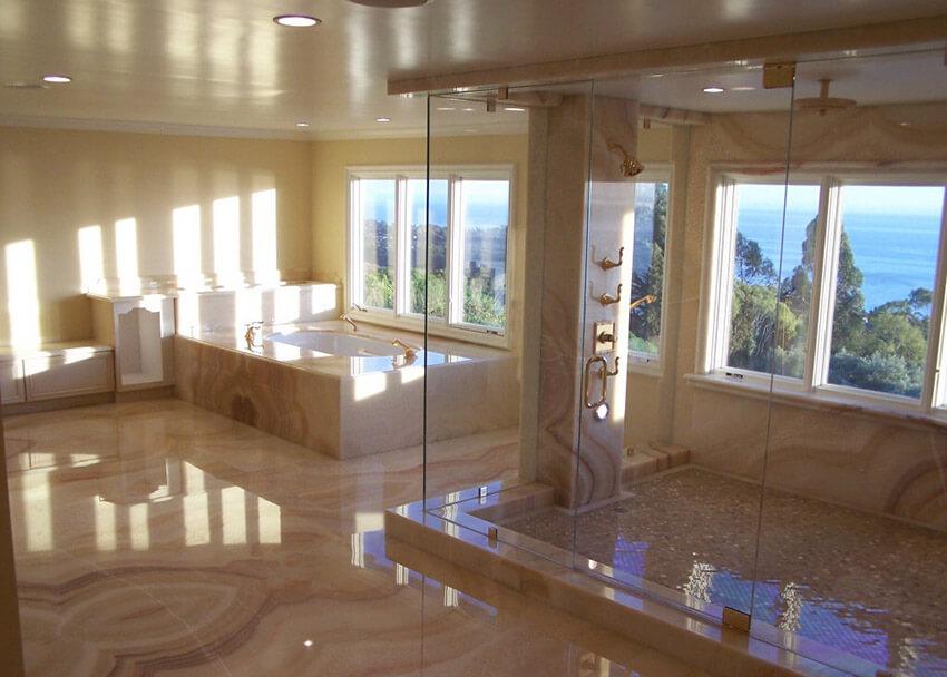 rainfall shower with frameless showerdoor in master bath