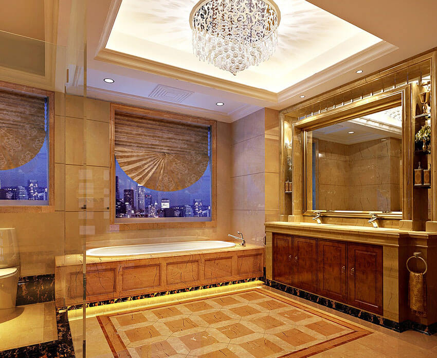 regal gold bathroom design with glass light fixture city view