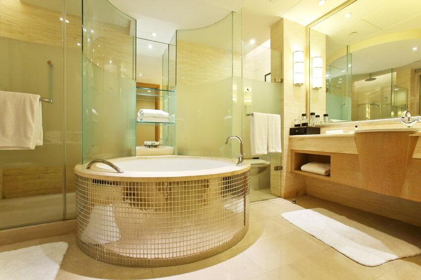 shiny gold tile bathtub glass shower