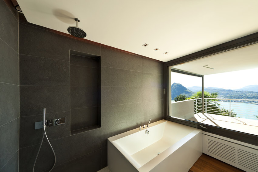 sleek modern bathroom with lake view