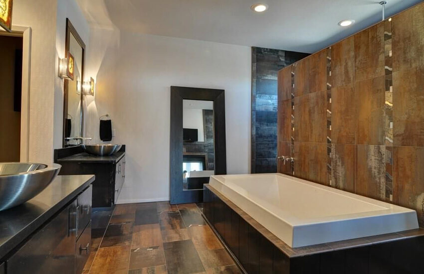 stylish contemporary master bathroom with tile accent wall