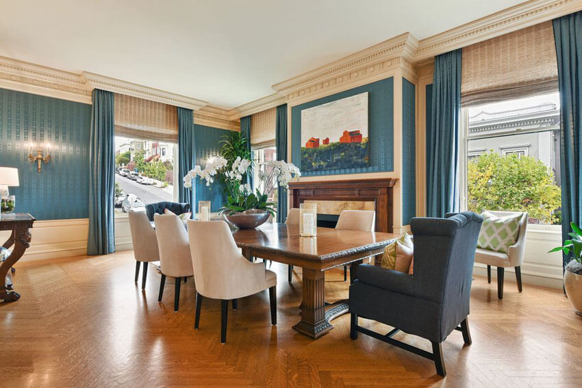 Traditional blue and beige color dining room with fireplace