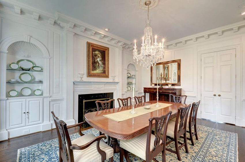 traditional dining room with wood table and chairs on an area rug