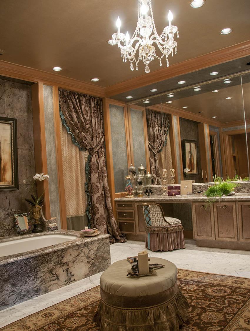 upscale designer bathroom with chandelier