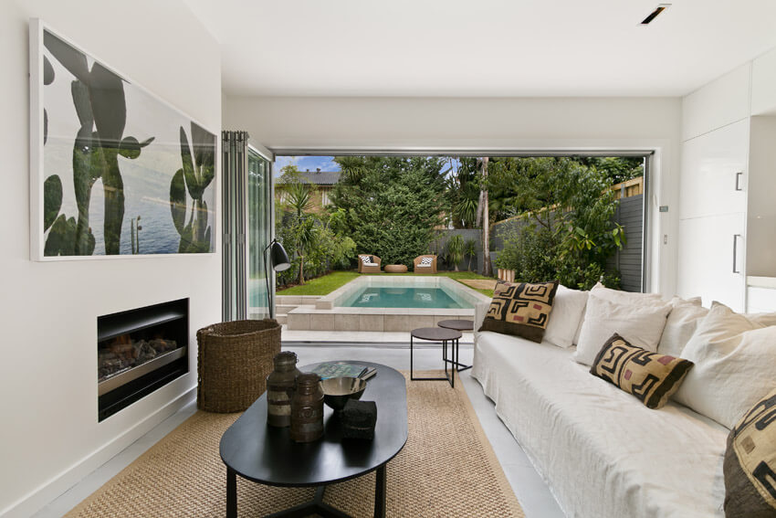 Upscale Living Room With Swimming Pool View