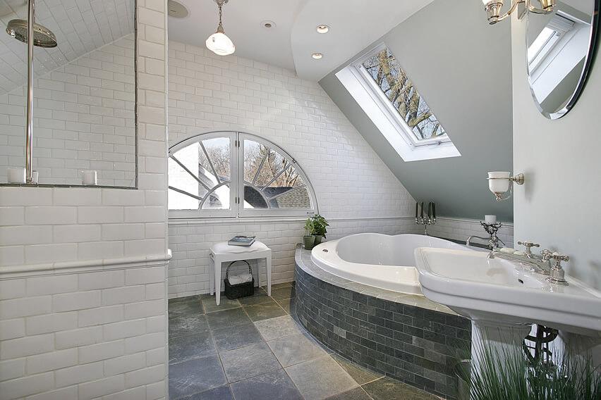 White brick bathroom with grey bath