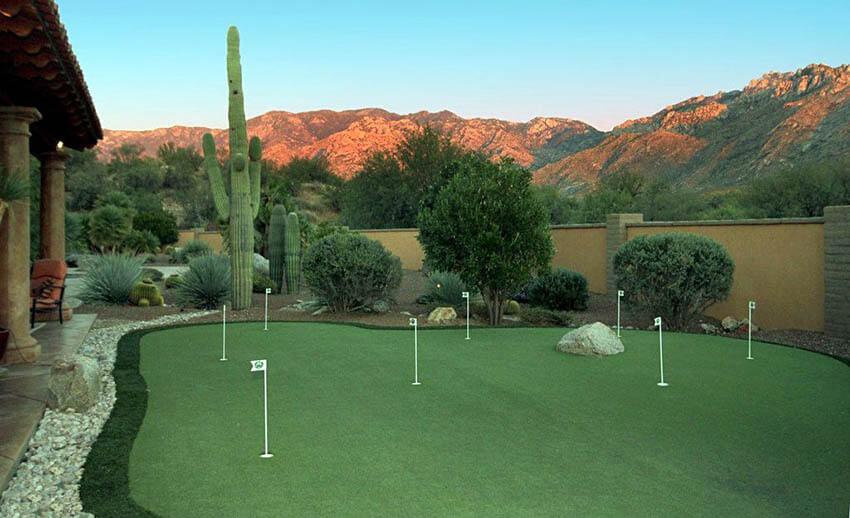 backyard golf putting green with mountain views