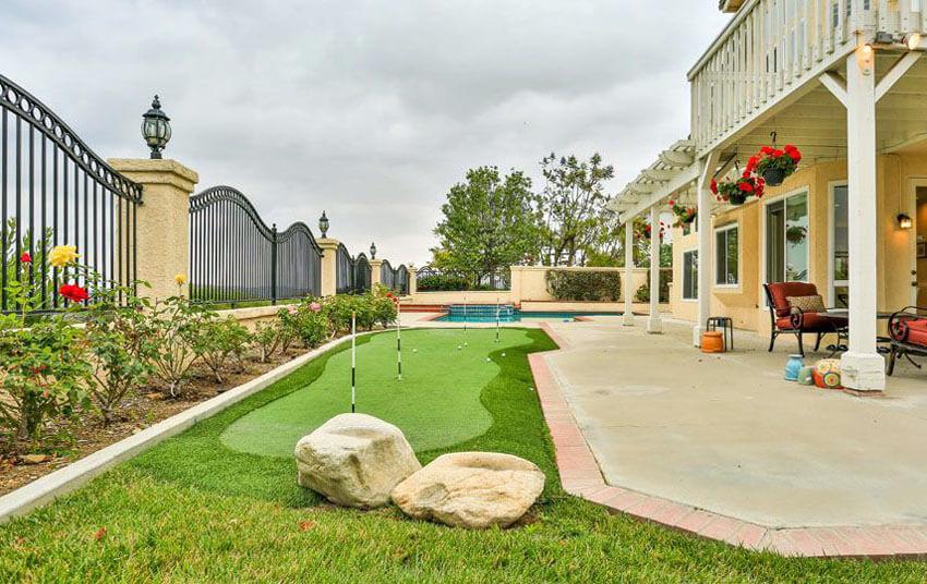 backyard putting green and swimming pool