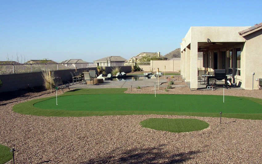 backyard putting green with desert style landscaping