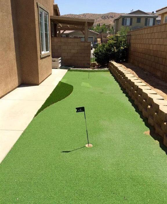 long putting green in backyard
