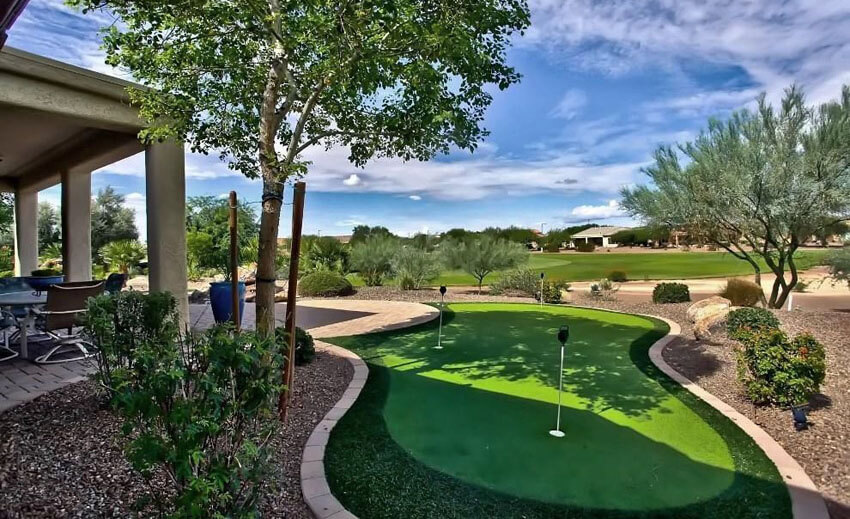 luxury backyard with shady putting green