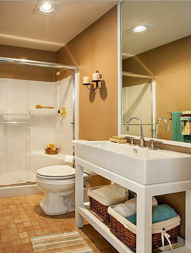 Bathroom design with brown wall and white toilets