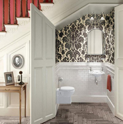 Bathroom under the staircase with wide door