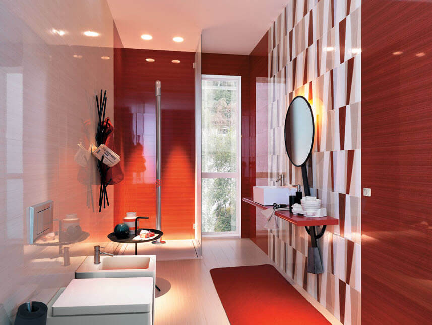 Bright bathroom with red tiles and white toilets