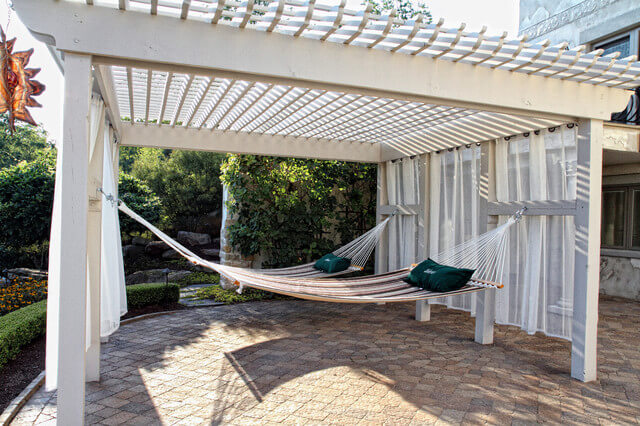 Hammocks on deck covered by wooden slats
