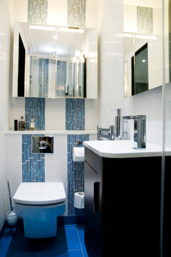 Modern and small blue and black bathroom