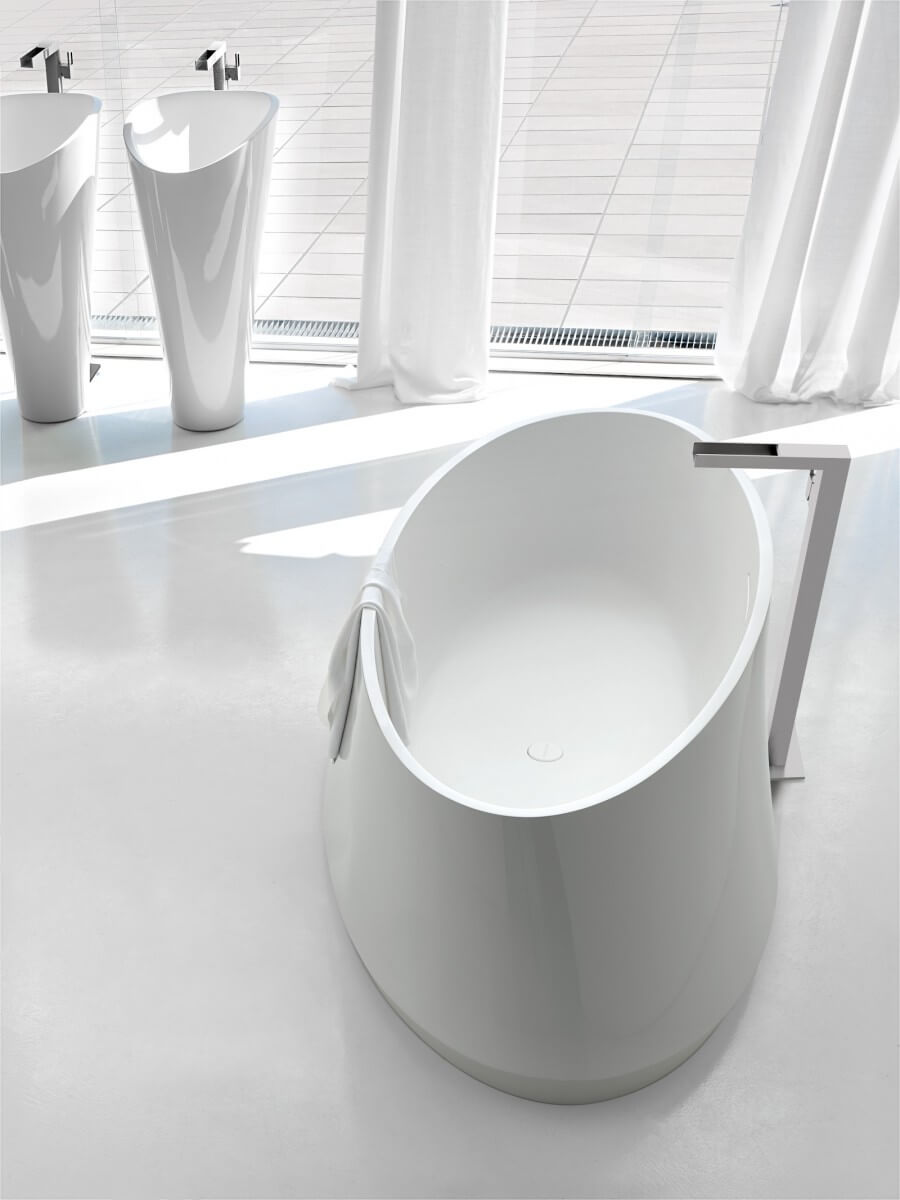 Oval tub and white double sink bathroom